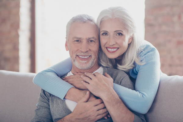 Portrait of happily married mature couple hugging